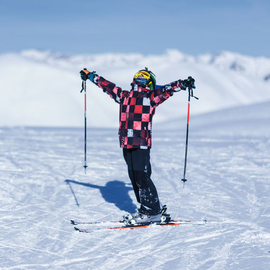 Boy skiing on snowcapped mountain