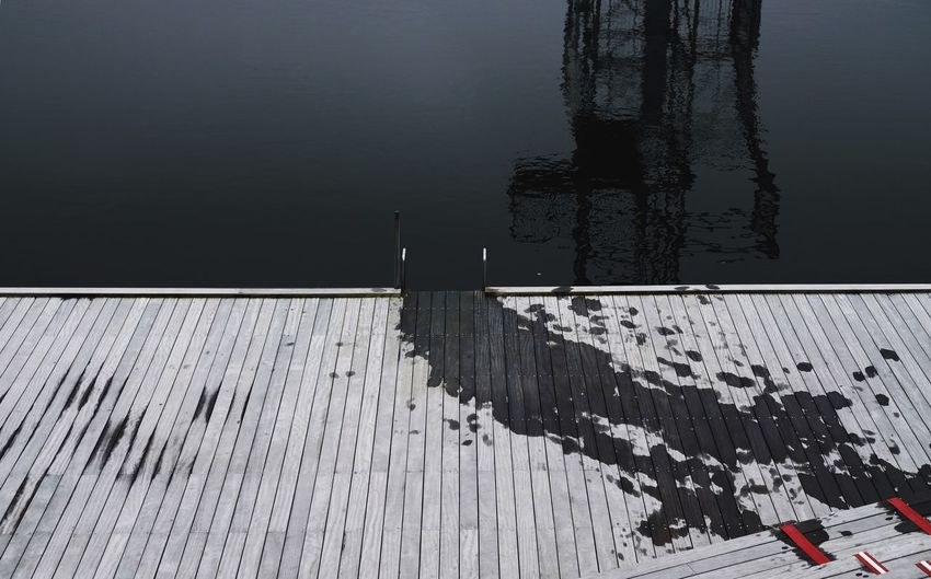 High angle view of reflection in lake during winter