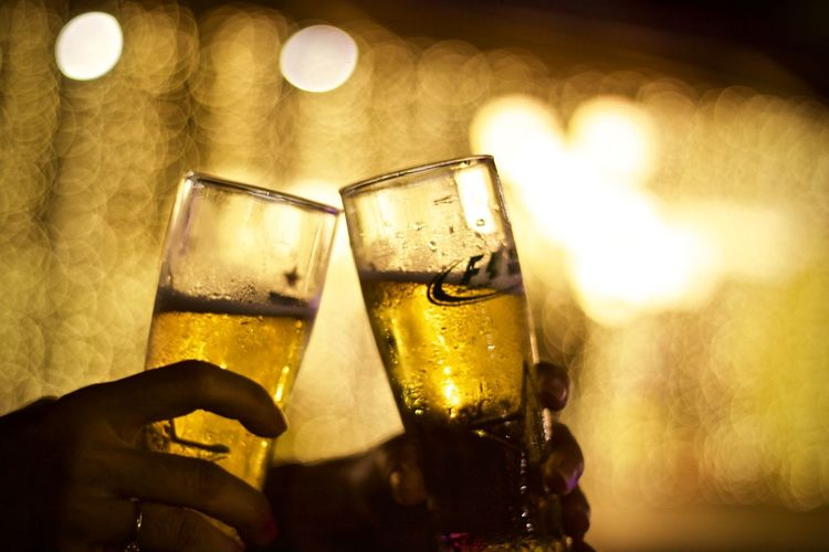 Refreshment Alcohol Drink Glass Human Hand Hand Human Body Part Food And Drink Holding Household Equipment Drinking Glass Beer Celebratory Toast Beer - Alcohol Focus On Foreground Smiling Celebration Illuminated Close-up Bar - Drink Establishment Beer Glass Nightlife Happy Hour Finger