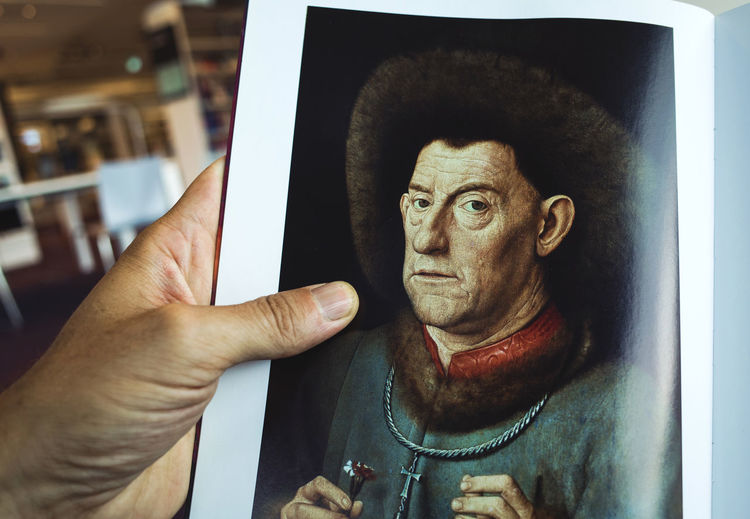 """""""Portrait of a man with carnation"""" 1435 by the greatest painter Jan van Eyck. Both the painter and the model lived 500 years ago. Art Arts Book Close-up Face Great Art Hand History Of Arts Human Face Human Representation Jan Van Eyck Learning Library Man Eyeemphoto Model Painting Portrait Quality Time Reading Studying Everyday Lives Colour Of Life What's On The Roll Everyday Life"""