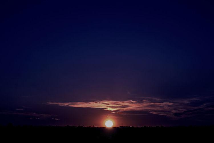 Beauty In Nature Blue Sun Blue Sunset Calm Set Cloud - Sky Dark Dramatic Sky Horizon Over Land Landscape Scenics Silhouette Sky Sunset Tranquil Scene