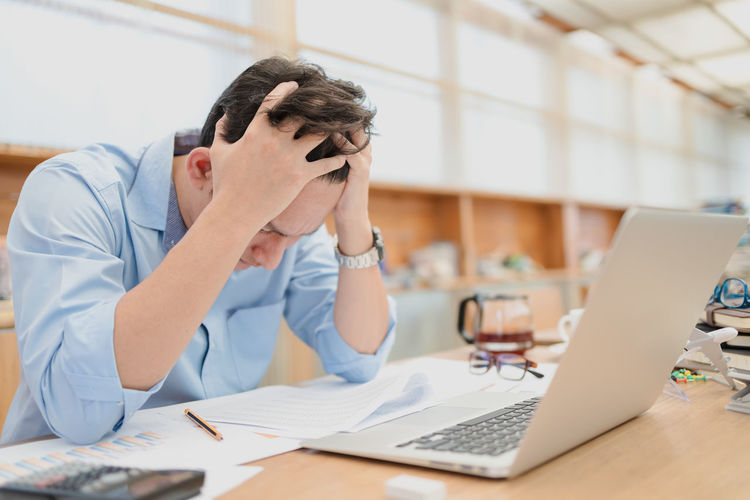 Frustrated businessman sitting at office