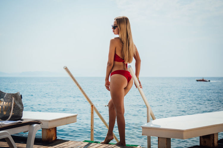 Water Sea Young Adult Young Women One Person Leisure Activity Standing Swimwear Sky Lifestyles Adult Women Fashion Real People Clothing Beauty Holiday Bikini Beautiful Woman Hair Hairstyle Horizon Over Water