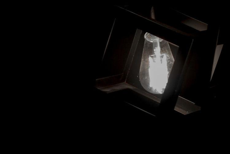 High angle view of illuminated window in darkroom