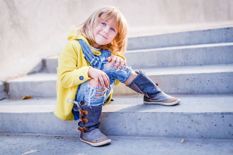 A stylish little blond boy on stairs at sunset Beautiful Blond Hair Boy Childhood Cute Elementary Age Family Fashion Happiness Happy Outdoors Slyle Smiling Sunset