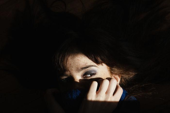 Close-up of woman looking away in darkroom