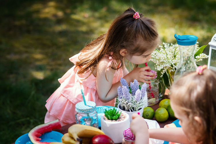Picnic Picnic Table Fruit Summer Forest Girl Childhood Child Kid Girls Females Women Food Food And Drink Togetherness Sitting Bonding Family Lifestyles Front View People Offspring Innocence Real People Day Healthy Eating Hairstyle Outdoors