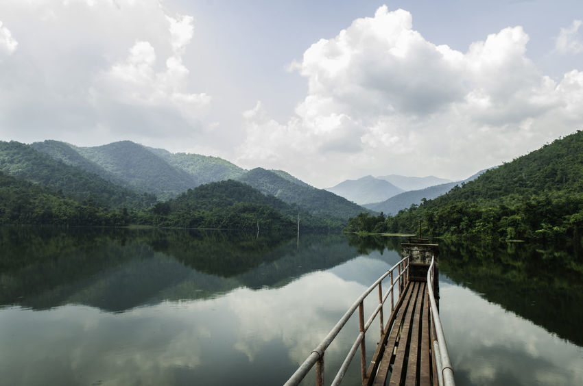 Beauty In Nature Bridge - Man Made Structure Cloud - Sky Day Lake Landscape Mountain Nature No People Outdoors Scenics Sky Tranquil Scene Tranquility Tree Vacations Water