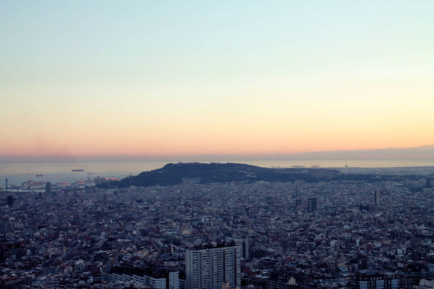 Barcelona España Clear Sky Copy Space Montjuic Setting Sun Architecture Building Exterior Built Structure City Cityscape Clear Sky Day High Angle View Nature Sea Sky Sunset Sunset Over Sea