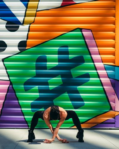 - Hashtag #yogapose Yoga Pose Composition Visual Creativity EyeEm Gallery Eye4photography  eyeemphoto Travcimages EyeEm EyeEm Best Shots Nycphotographer Lifestyles Multi Colored One Person Women Wellbeing Yoga Graffiti