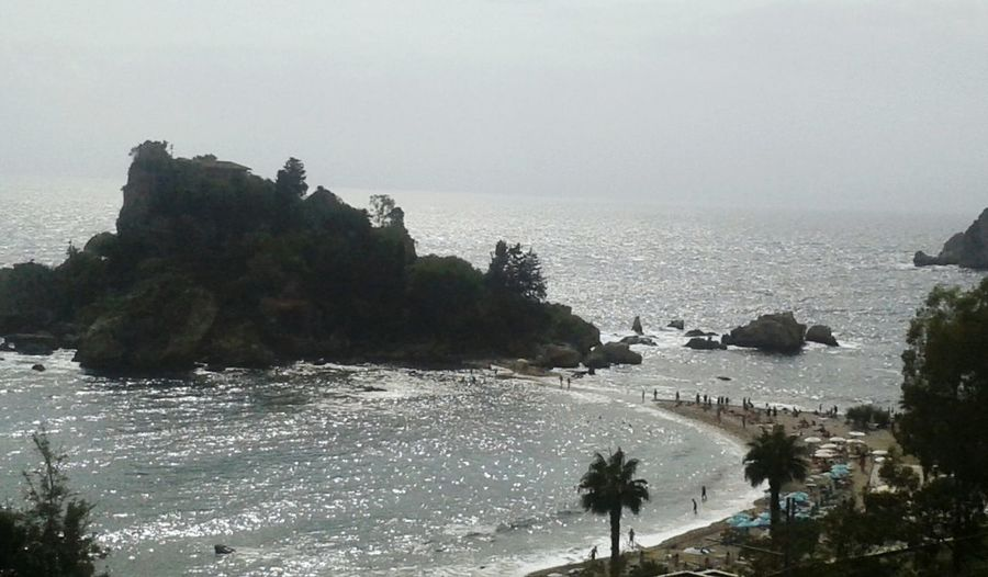 L'isolabella Summertime Sea Summertime Taormina Sicilia Visitsicily Cartolina Waterfront Landscape Water Tranquil Scene Horizon Over Water Scenics Tree Beach Tranquility Beauty In Nature Tourism Non-urban Scene Outdoors Rock Formation Cliff