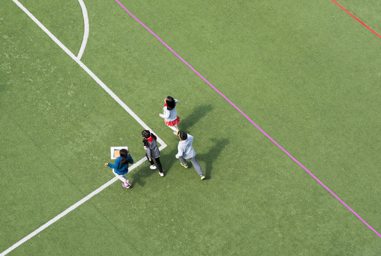 High Angle View Of Children Running On Court