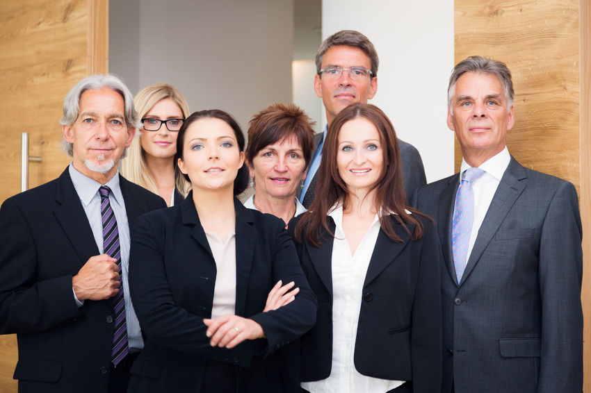Business Company Office Teamwork Well Dressed Business Finance And Industry Business Person Businessman Businesswear Businesswoman Caucasian Group Group Of People Group Shot Indoors  Men People Portrait Professional Team Togetherness Women