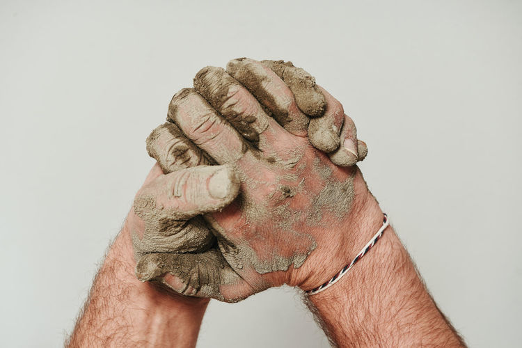 Hand Studio Shot Human Hand White Background One Person Indoors  Human Body Part Men Body Part Finger Close-up Human Finger Creativity Art And Craft Wrinkled Fist Adult Mature Adult Senior Adult