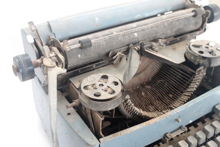 Close-up of vintage typewriter over white background