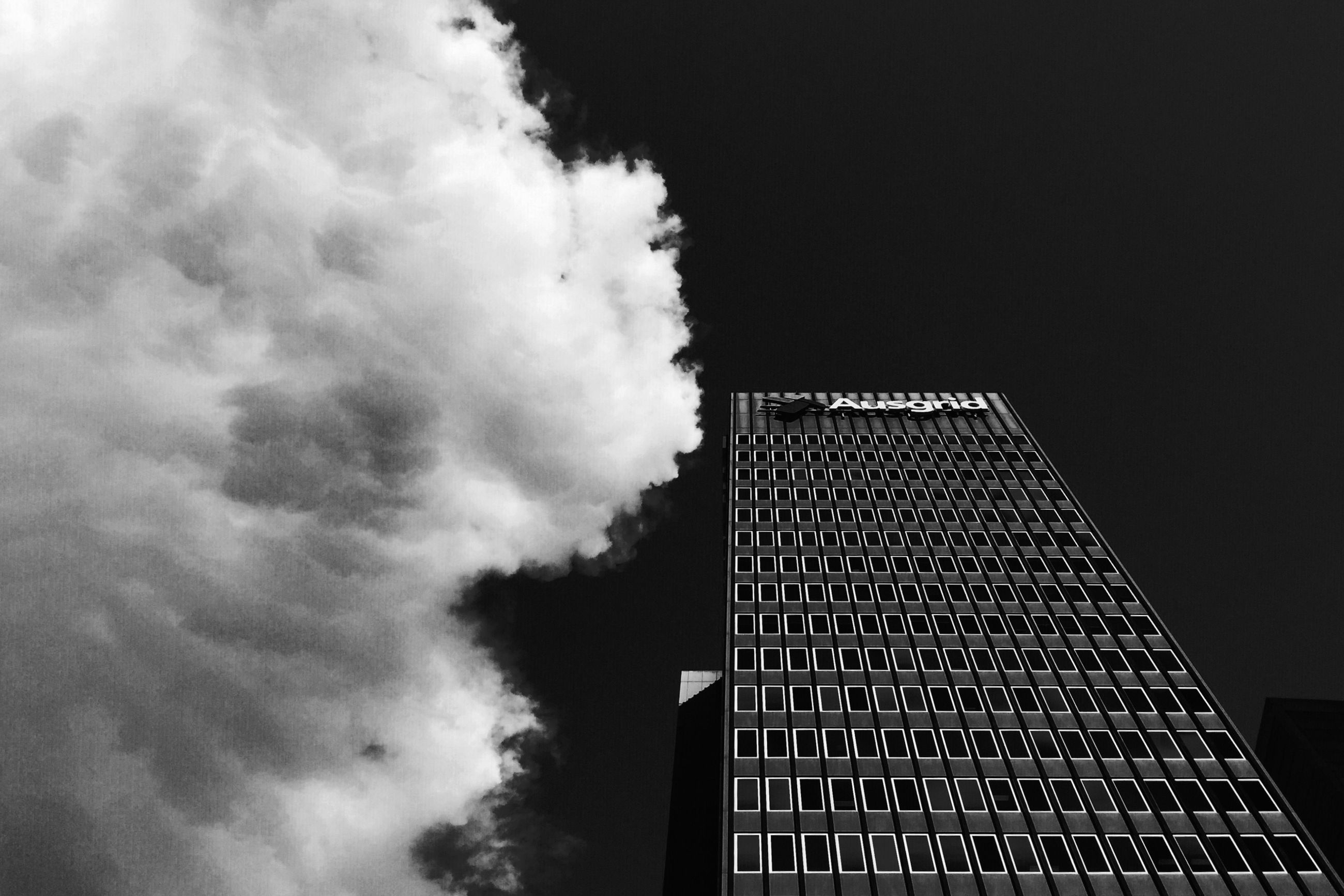architecture, low angle view, built structure, sky, building exterior, tall - high, tower, modern, cloud - sky, building, outdoors, city, metal, skyscraper, no people, dusk, tall, office building, night, development