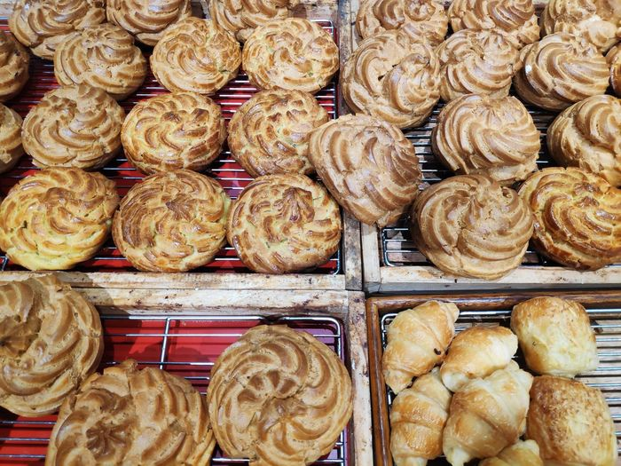 High angle view of sweet food on cooling racks in bakery
