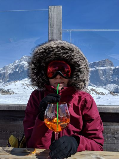 Goggles Aperol Spritz Sitting Warm Clothing Mountain Headwear Snow Water Front View Sky Snow Covered Snowcapped Snowcapped Mountain Mountain Range Rocky Mountains