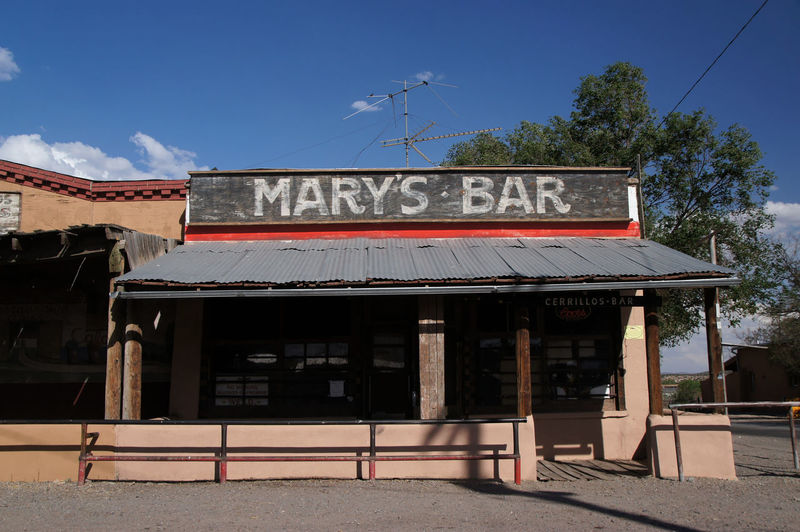 Architecture Bar Building Exterior Built Structure Communication Day Empty Mary's Bar New Mexico No People Outdoors Roof Sign Sky Text Tree USA