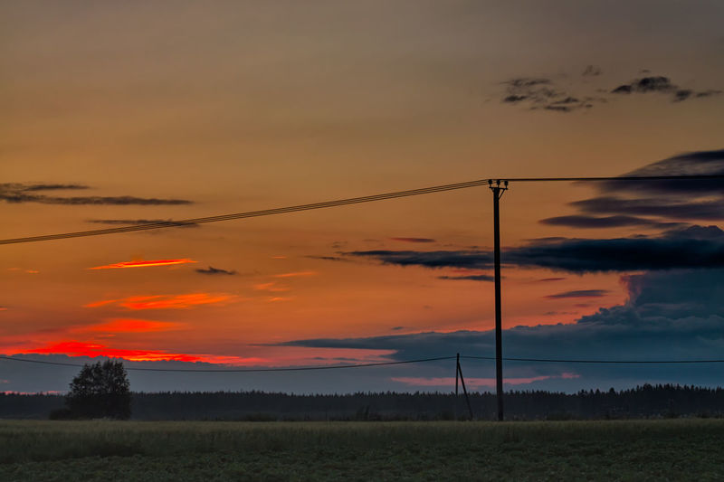 Sunset On A Summer Night Beauty In Nature Cloud Cloud - Sky Cloudy Dramatic Sky Field Horizon Over Land Idyllic Landscape Moody Sky Nature No People Non Urban Scene Non-urban Scene Orange Color Outdoors Power Line  Power Supply Remote Rural Scene Scenics Sky Sunset Tranquil Scene Tranquility