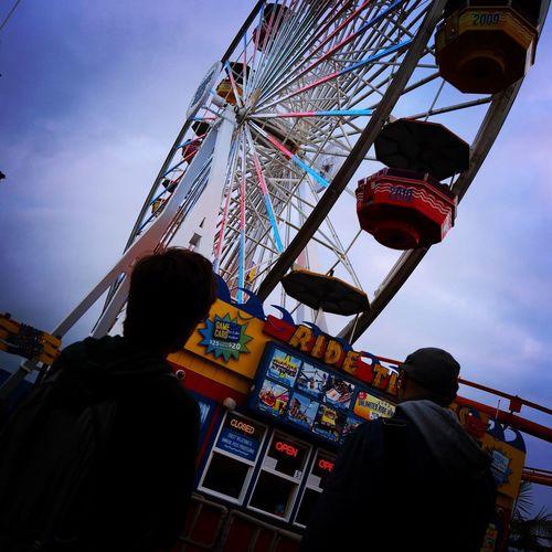 (c) Martina Schenk Amusement Park Amusement Park Ride Arts Culture And Entertainment Clear Sky Day Ferris Wheel Ferris Wheel Fun Instagram Leisure Activity Los Ángeles Low Angle View Men Outdoors Pacific Rim People Real People Rear View Santa Monica Santa Monica Pier Santa Monica, California Sky Standing Sundown