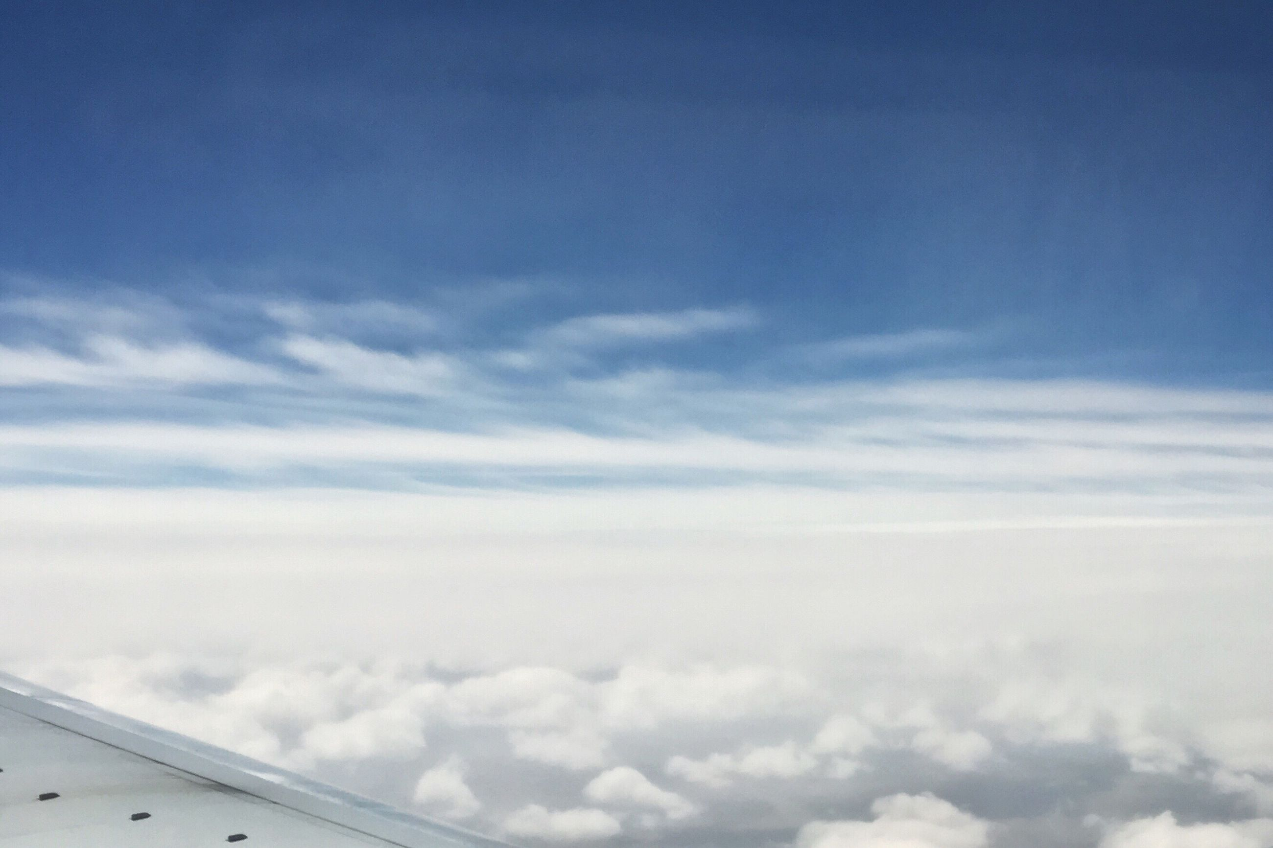 sky, cloud - sky, blue, low angle view, cloud, nature, scenics, cloudy, beauty in nature, tranquility, white color, day, outdoors, tranquil scene, cloudscape, no people, copy space, transportation, white, weather
