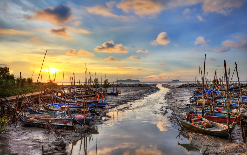 fisherman boat floats on the river near old wooden jetty and the bridge during sunset Penang Food Sunlight Sunset_collection Cloud - Sky Day Fisherman Boat Fishing Harbor Hdr Edit Horizon Jetty Landscape Malaysia Moored Nautical Vessel Outdoors Sailboat Scenery Sea Seaside Shore Sunset Tarditional Boat Tranquility Water