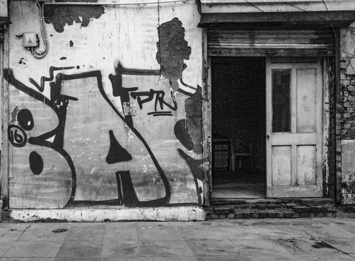 Graffiti on wall of old building