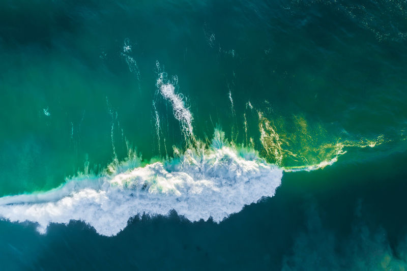 Aerial view of water splashing in sea