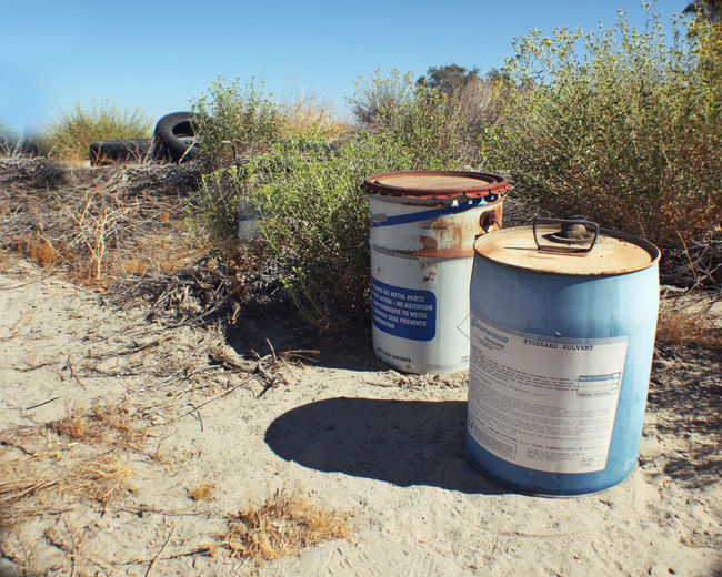 Chemicals Junk Salton Sea Tires Abandoned Barrel Chemical Containers Clear Sky Desert Junk Drum - Container Drums Methlab Nature No People Outdoors Pollution Solvents Sunlight