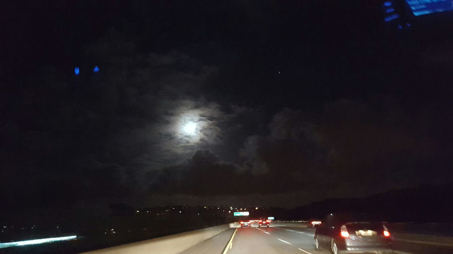 Cloud - Sky Cloudy Diminishing Perspective Highway Illuminated Journey Land Vehicle Mode Of Transport Motion Nature Night No People On The Move Outdoors Overcast Road Road Marking Scenics Sky The Way Forward Transportation Vanishing Point Weather Windshield