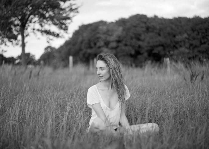 Land Plant Field One Person Real People Leisure Activity Young Adult Grass Lifestyles Selective Focus Casual Clothing Young Women Women Nature Three Quarter Length Day Growth Portrait Hair Beautiful Woman Hairstyle Outdoors Analogue Photography Analog Medium Format