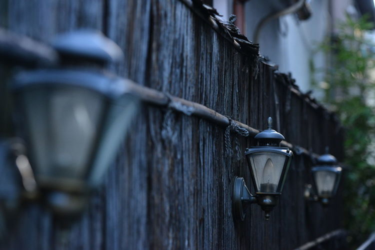 Close-up of wall lamps in a row