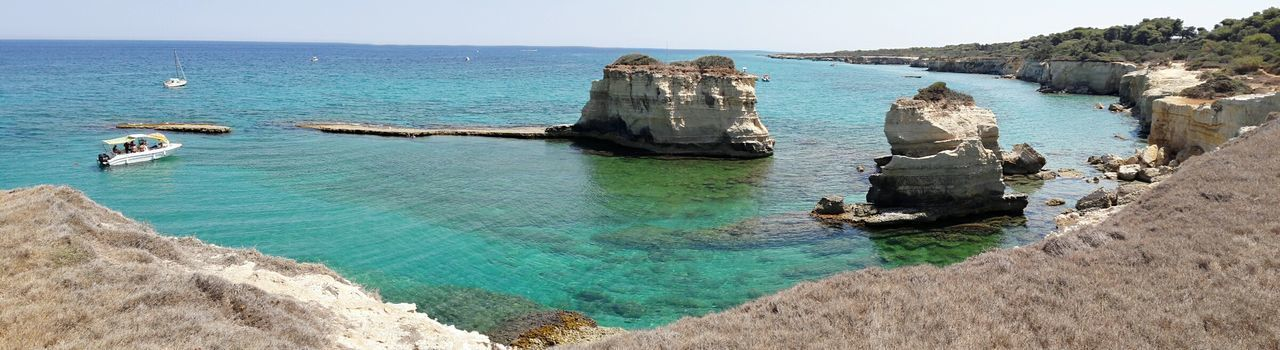 Sea Water Beach Rock - Object Outdoors No People Beauty In Nature Rocks And Water Sant'andrea Italian Seaside Puglia Relaxation Beauty In Nature Clear Sky Travel Destinations Summer Blue Horizon Over Water Vacations Emerald Water Turquoise Water Turquoise Colored Turquoise