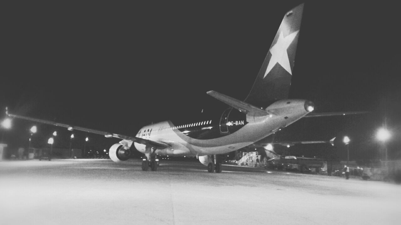 airplane, transportation, travel, air vehicle, mode of transport, night, outdoors, no people, illuminated, runway, fighter plane, sky
