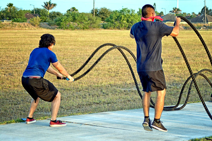 Motion Exercise Equipment Rope Exercise Men Two People Full Length Males  Casual Clothing Day Nature Adult Standing Plant Sport Rear View Leisure Activity Togetherness Real People People Playing