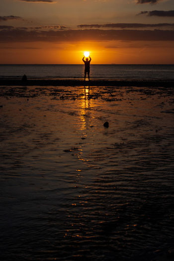 Catch The Sun. Thanet Catch The Sun Margate Margate Sunset Malephotographerofthemonth Water Low Tide Full Length Sea Sunset Beach Standing Beauty Silhouette Sunlight Romantic Sky The Great Outdoors - 2018 EyeEm Awards The Traveler - 2018 EyeEm Awards