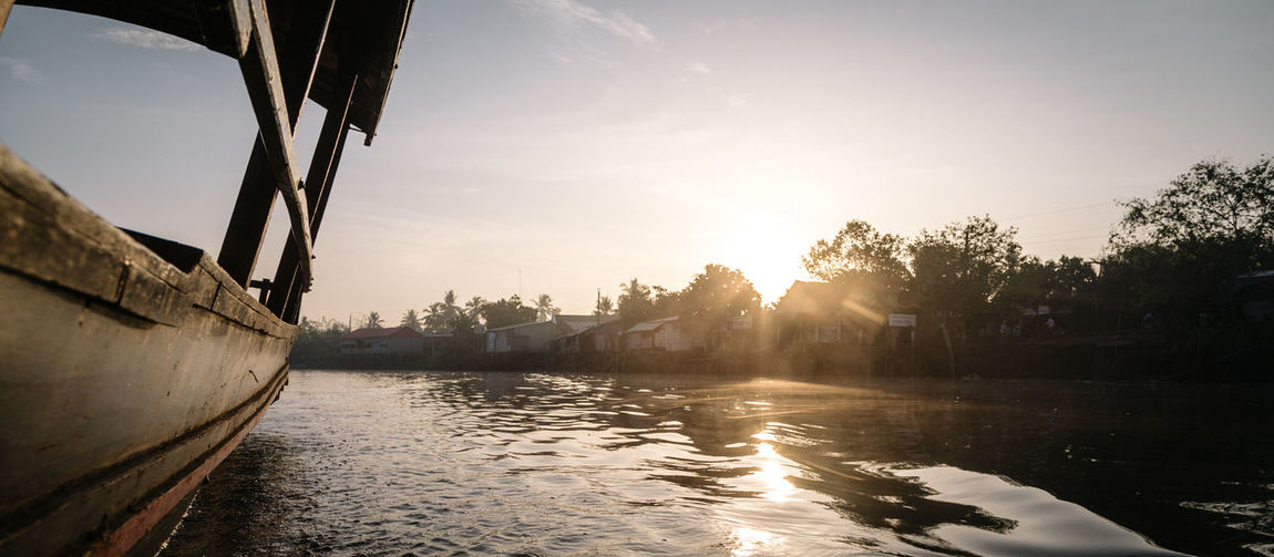 Floating Market Sunrise, Ben Tre, Vietnam Architecture Beauty In Nature Building Exterior Day Early Morning Floating Floating Market Floating On Water Mekong Mekong River Nature Nautical Vessel No People Outdoors Reflection River Riverside Sky Sunlight Sunrise Sunset Tree Vietnam Water Waterfront