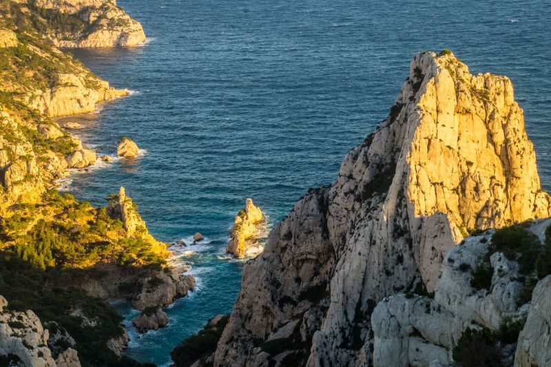 marseille,calanque,bouche du rhone, france Sea Rock Water Rock - Object Solid Rock Formation Beauty In Nature Nature Scenics - Nature No People Land Yellow High Angle View Cliff Tranquility Beach Day Blue Tranquil Scene Outdoors Rocky Coastline Stack Rock Eroded