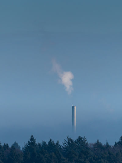 Air Pollution Chimney Clean Air Day Emitting Environment Factory Fumes Industry Nature No People Outdoors Pollution Sky Smoke - Physical Structure Smoke Stack Tree