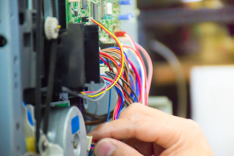 Cropped hand of man repairing electrical equipment