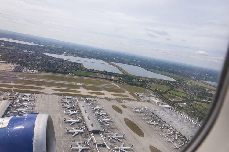 Initial climb from Heathrow Airport, London view at the stacked line of BA planes Airport At The Airport Ba British Airways From An Airplane Window Heathrow