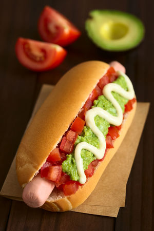 Chilean Completo Italiano (Italian) traditional hot dog sandwich, made of bread, sausage, tomato, avocado and mayonnaise, photographed on dark wood with natural light (Selective Focus, Focus one third into the hot dog) Chile Chilean  Completo Homemade Homemade Food Roll Sandwich Avocado Bread Bun Chilean Food Completo Italiano Fast Food Food Food And Drink Freshness Hot Dog Mayonnaise Meat Processed Meat Ready-to-eat Sausage Snack Tomato Vegetable