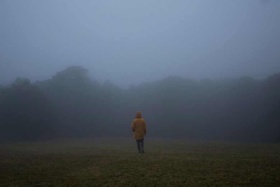 The mist Fog One Person Field Land Beauty In Nature Full Length Plant Real People Nature Rear View Landscape Environment Scenics - Nature Tranquility Lifestyles Sky Leisure Activity Winter Warm Clothing