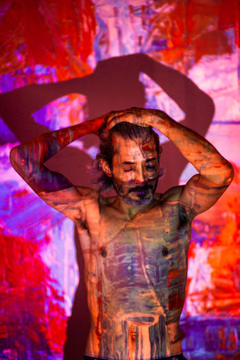 Full length of man holding multi colored light painting