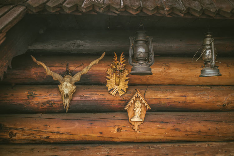Close-up of old hanging on wall