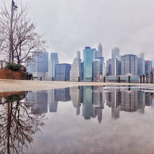 Reflection of city on water