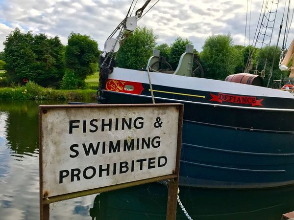 """""""Let's go fishing!"""" River Medway Maidstone Barge Mooring Riverside Defiance No Fishing No Swimming Tow Path Thames Barge"""