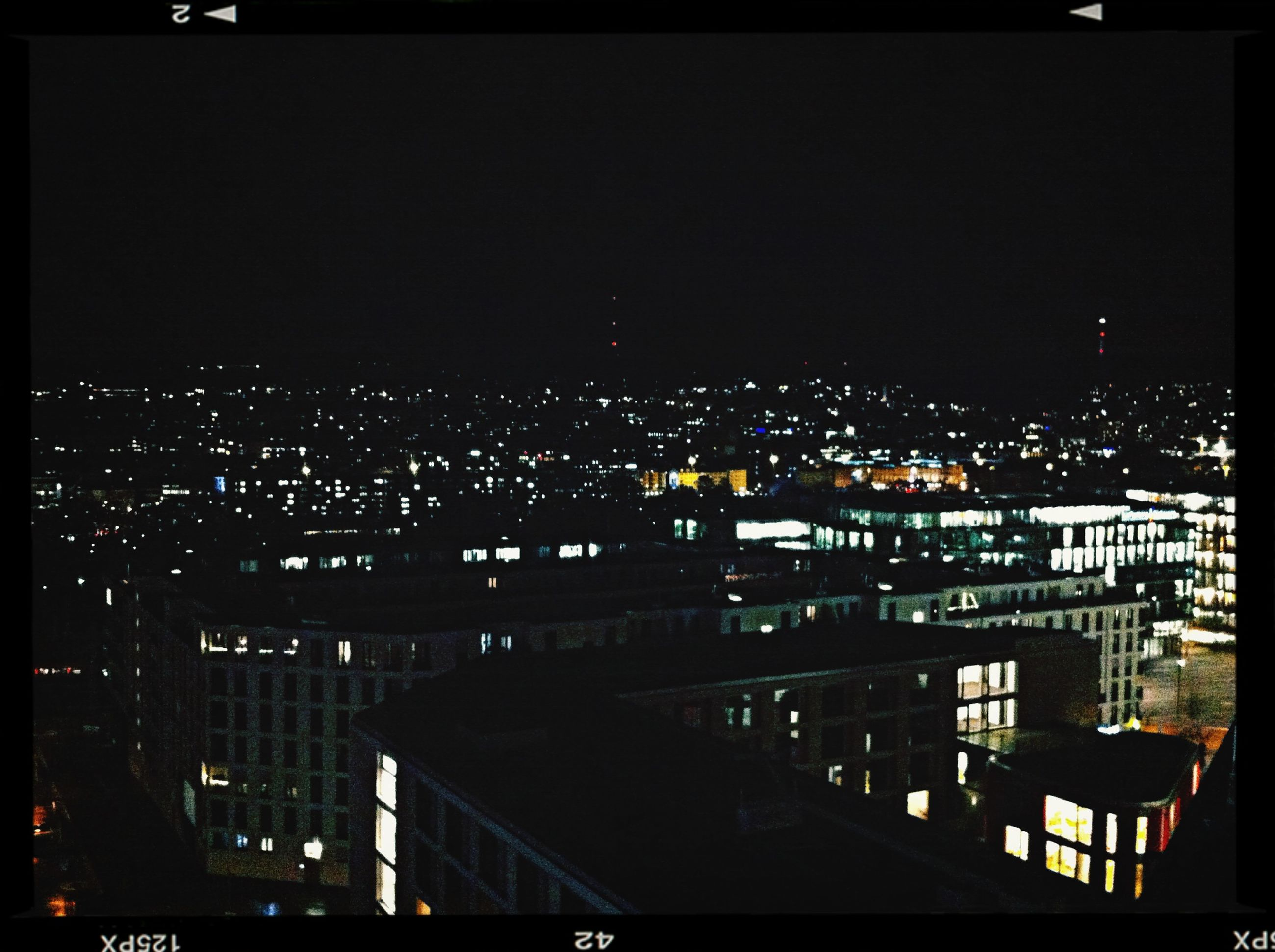 night, illuminated, building exterior, city, architecture, cityscape, built structure, crowded, high angle view, skyscraper, residential district, city life, residential building, dark, sky, modern, residential structure, office building, copy space, transfer print
