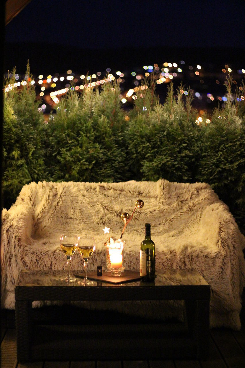 illuminated, night, candle, nature, no people, fire, burning, flame, land, event, architecture, lighting equipment, table, celebration, alcohol, fire - natural phenomenon, heat - temperature, decoration, bottle, plant, glass, outdoors